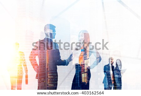 Transparent businesspeople silhouettes on Moscow city background. Double Exposure