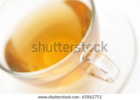 Transparent cup of tea on white (close-up)