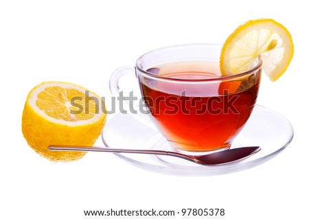 Transparent cup with black tea with a lemon and spoon isolated on white background