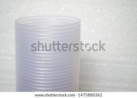 transparent disposable plastic cups on wooden table #1475880362