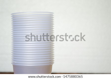 transparent disposable plastic cups on wooden table #1475880365