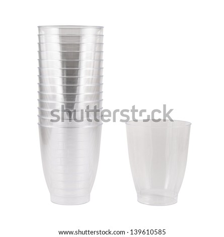 Transparent disposable plastic cups, single and pile stack, isolated over white background