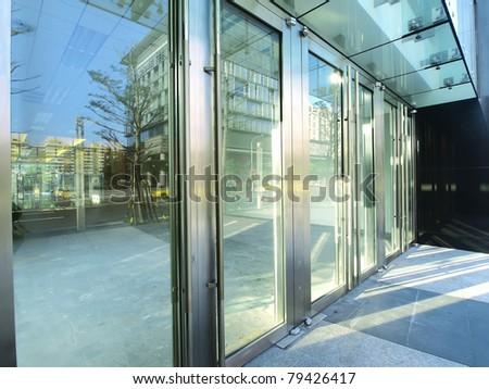 Transparent door of modern building #79426417