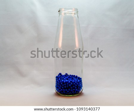 Transparent glass bottle #1093140377