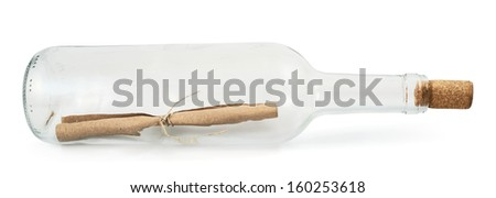 Transparent glass bottle lying on its side with a message inside, isolated over white background