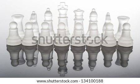 transparent glass chess pieces - stock photo