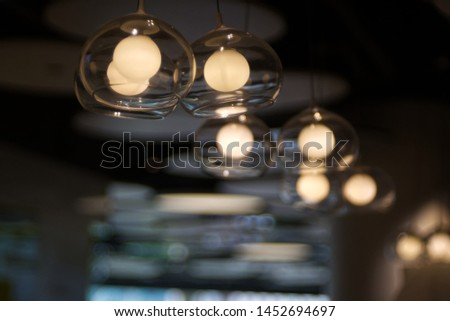 Transparent glass is covered yellow ball like light probe with bubble blur background #1452694697