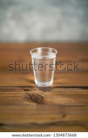 Transparent glass of water on a wooden table. #1304873668
