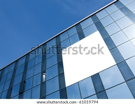 transparent glass wall with blank placard of skyscraper