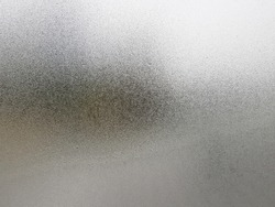 Transparent glass with fog up and water drop on it during winter season.Close up shot of Natural beauty effect. Background and wallpaper concept.