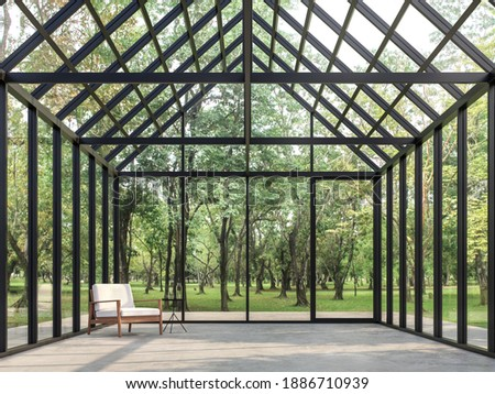 Transparent house empty room inside with nature view 3d render, polished concrete floor, glass walls and roof, looking out to see nature, sunlight into room.