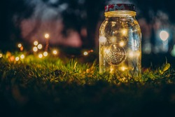 Transparent mason jar with lights from led in forest in the sunset. İstanbul 2018