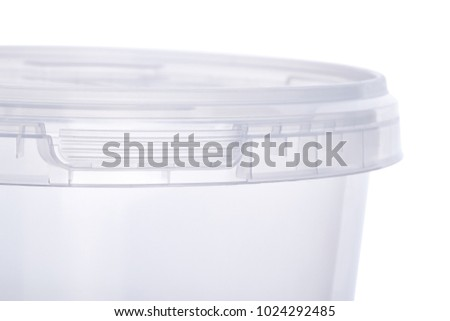 Transparent oval plastic bucket with transparent lid, plastic containers on white background, food plastic box isolated on white, product packaging for foodstuff or paints, adhesives, sealants
