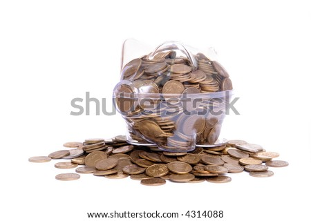 Transparent piggybank filled with Polish one grosz coins standing on coin pile over white background