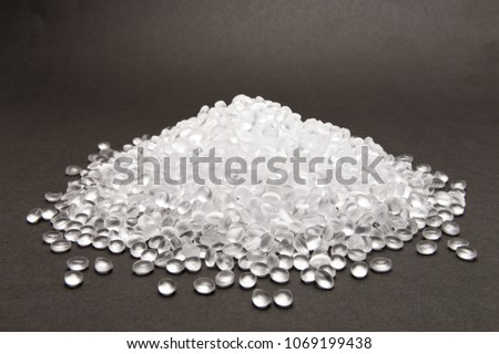 Transparent Polyethylene granules on dark .HDPE Plastic pellets.  Plastic Raw material . IDPE.