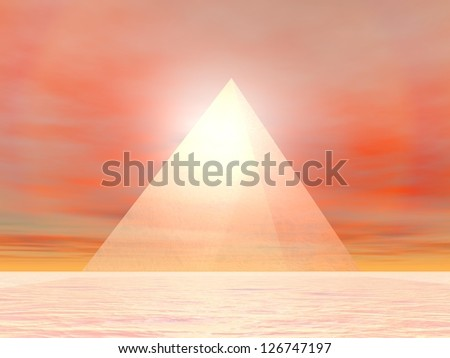 Transparent pyramid made of glass in front of sunset