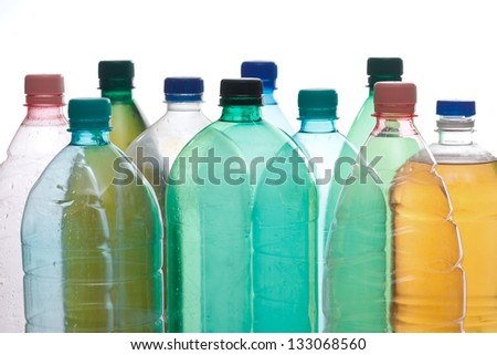 Transparent recyclable plastic bottles in different color