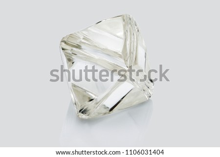 Transparent rough diamond isolated on white background.