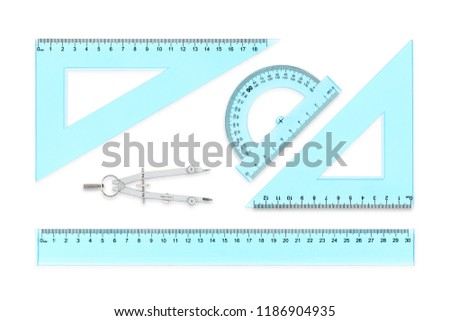 transparent rulers, protractor and compasses isolated on white