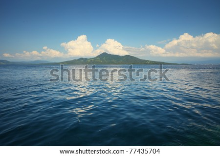 Transparent sea and white clouds. Bunaken island. indonesia