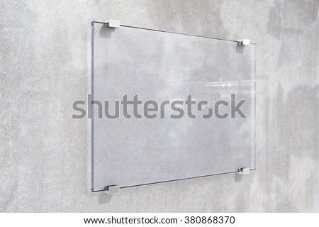 Transparent signboard on concrete wall, mock up #380868370