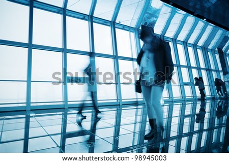 transparent viewing observatory in highrise building with tourists - stock photo