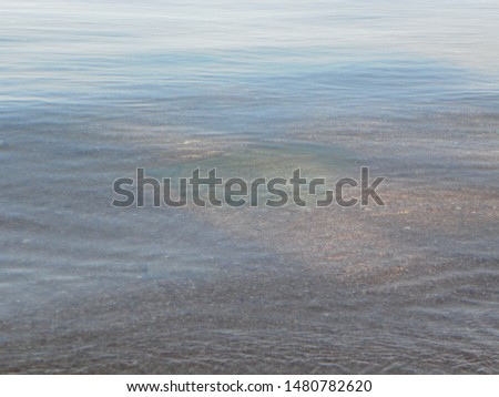Transparent water of the lake, calm and calm