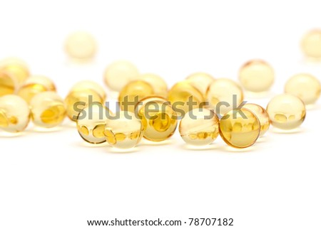 Transparent yellow capsules isolated on white