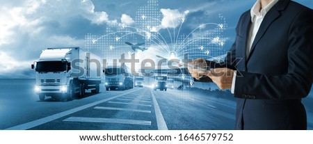 Transport and logistic concept, Freight shipping online, Businessman using tablet and data for global logistic network distribution on world map background, Business and technology, Blue tone. ストックフォト ©