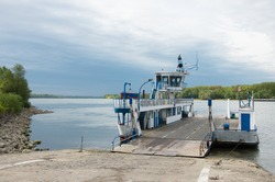 transport ferry docking on the banks of the danube river, Vac, Hungary