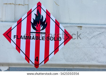 Transport hazard label for flammable solid cargo