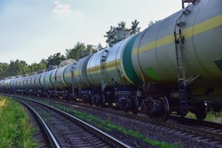 Transport tank car LNG by rail, gas - oil products. LPG transport propane. The fuel train, rolling stock with petrochemical tank cars. Liquefied natural gas export. Soft focus, possible granularity