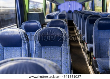 transport, tourism, road trip and equipment concept - travel bus interior