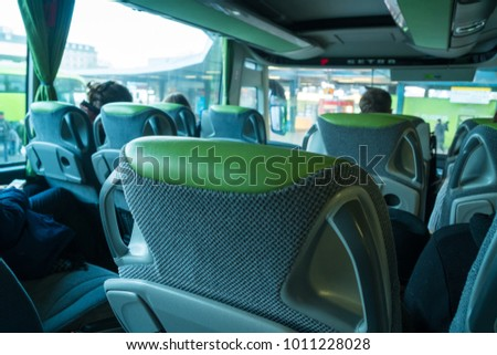transport, tourism, road trip and equipment concept - travel bus interior and seats. #1011228028