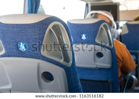 transport, tourism, road trip and equipment concept - travel bus interior and seats. #1163516182