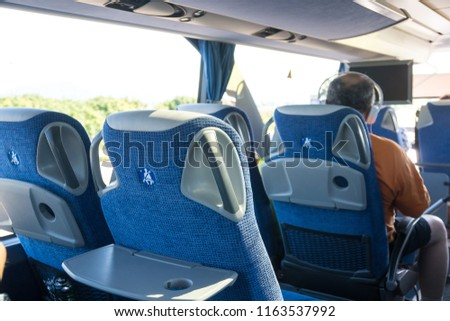 transport, tourism, road trip and equipment concept - travel bus interior and seats. #1163537992