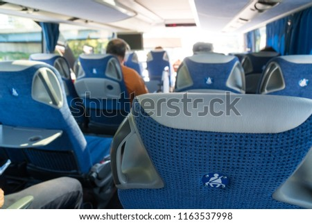 transport, tourism, road trip and equipment concept - travel bus interior and seats. #1163537998