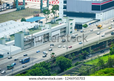 Transport traffic on bridge by the urban city district of Singapore #1246950703