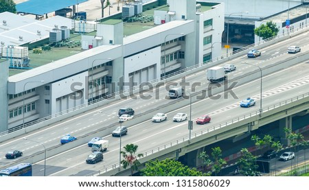 Transport traffic on bridge by the urban city district of Singapore #1315806029