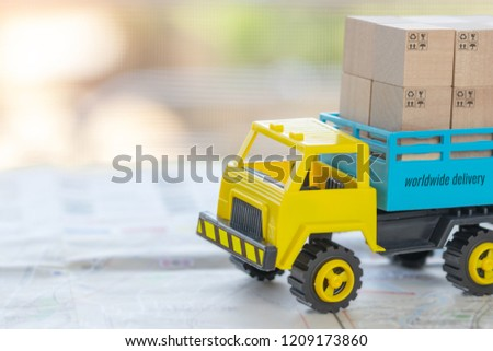 Transport truck with wooden box with symbols, up, recycle, fragile, keep dry, on street map. Logistics and transportation management ideas and Industry business commercial concept.