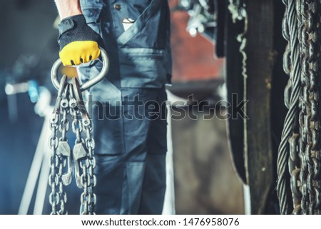 Transportation Industry Worker with Heavy Duty Support Chains Closeup Photo. Industrial Theme.