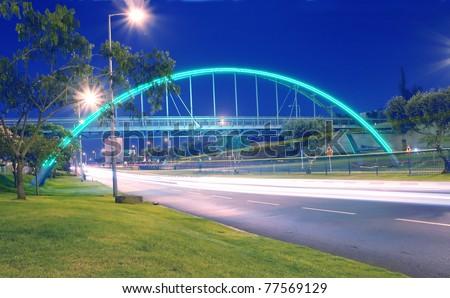transportation long exposure with modern bridge night scene