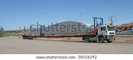 Transportation of a wing of the wind turbine by truck on roads of Spain