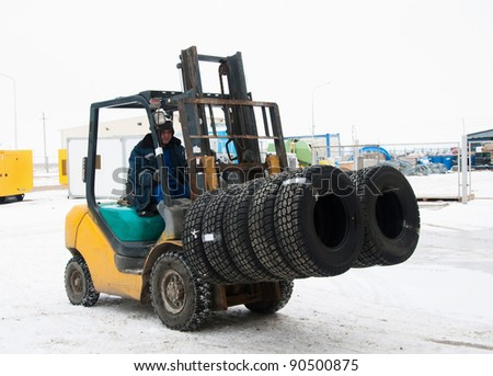 Transportation of autotyres by a loader