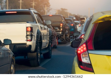 Transportation of cars on the road. Open light break waiting to release traffic signals in the intersection. Heading to travel or work. On the asphalt road. #1294361662