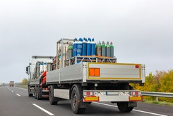 Transportation of cylinders with oxygen for patients with coronavirus. Truck delivering gas cylinders for medical purposes