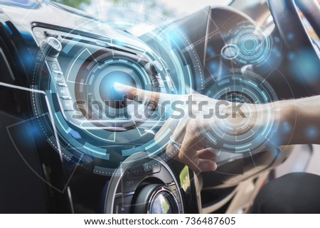 Transportation,technology and vehicle concept - man using car system control pushing panel button touch screen interface modern design,GPS and DVD ,Vintage color #736487605
