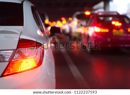 Photo of  transportation vehicle and traffic concept - Blurred traffic jam and brake light in bangkok, thailand on evening