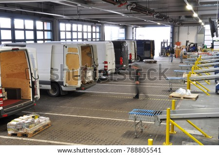 transporter in the handling of a company for the dispatch of goods - loading with daily newspapers in a printing company