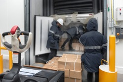 Transporting goods in the loading goods of the freezing warehouse. Storage for Ready-made foods or Ready-to-Eat Foods. Export-Import Logistics system concept.